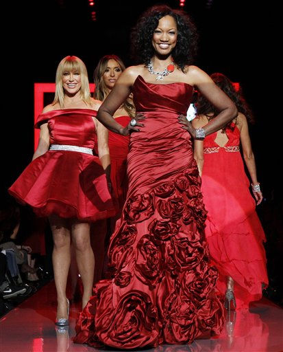"<div class=""meta image-caption""><div class=""origin-logo origin-image ""><span></span></div><span class=""caption-text"">Garcelle Beauvais, center, walks the runway wearing a dress designed by Monique Lhuiller with Suzanne Somers, left, in Ina Soltani behind her during the Heart Truth Red Dress Fall 2011 show in New York, Wednesday, Feb. 9, 2011.  (AP Photo/Kathy Willens) (AP Photo/ Kathy Willens)</span></div>"