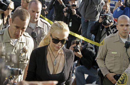 "<div class=""meta ""><span class=""caption-text "">Lindsay Lohan arrives at Los Angeles Superior Court, Wednesday, Feb. 23, 2011, where a judge said he  he would sentence her to jail if she accepted a plea deal from prosecutors to avoid trial for allegedly stealing a $2,500 necklace from an upscale jewelry store.  She was due back in court on March 10.  (AP Photo/ Reed Saxon)</span></div>"
