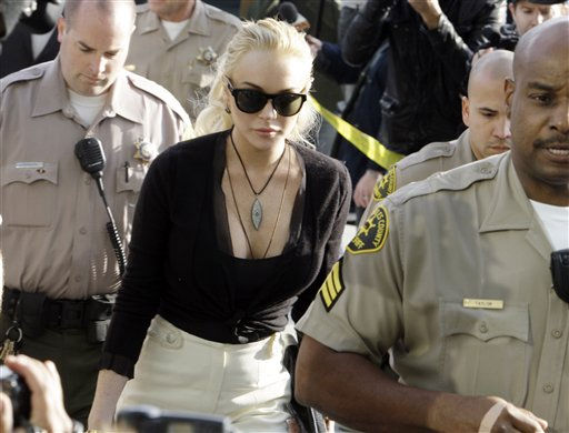 "<div class=""meta image-caption""><div class=""origin-logo origin-image ""><span></span></div><span class=""caption-text"">Lindsay Lohan arrives at Los Angeles Superior Court, Wednesday, Feb. 23, 2011, where a judge said he  he would sentence her to jail if she accepted a plea deal from prosecutors to avoid trial for allegedly stealing a $2,500 necklace from an upscale jewelry store.  She was due back in court on March 10.  (AP Photo/ Reed Saxon)</span></div>"