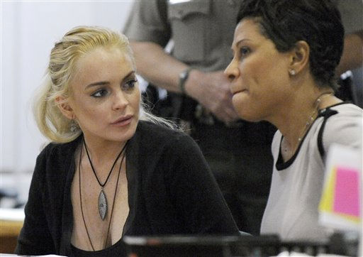 "<div class=""meta ""><span class=""caption-text "">Lindsay Lohan arrives at Los Angeles Superior Court, Wednesday, Feb. 23, 2011, where a judge said he  he would sentence her to jail if she accepted a plea deal from prosecutors to avoid trial for allegedly stealing a $2,500 necklace from an upscale jewelry store.  She was due back in court on March 10.  (AP Photo/ Paul Buck)</span></div>"