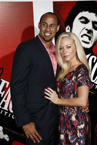 Kendra Wilkinson, right, and Hank Baskett arrive at &#34;Scarface&#34; Legacy Celebration Event in Los Angeles, Tuesday, Aug. 23, 2011. &#34;Scarface&#34; will be released on Blu-ray September 6, 2011.  &#40;AP Photo&#47;Matt Sayles&#41; <span class=meta>(AP Photo&#47; Matt Sayles)</span>