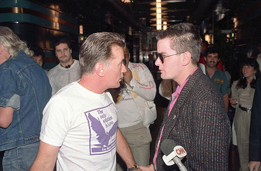 Actor Martin Sheen, left, who was arrested for staging a sit-in to protest the Strategic Defense Initiative, talks with his son Charlie Sheen in New York City on July 7, 1987.  &#40;AP Photo&#47;Richard Drew&#41; <span class=meta>(AP Photo&#47; RICHARD DREW)</span>