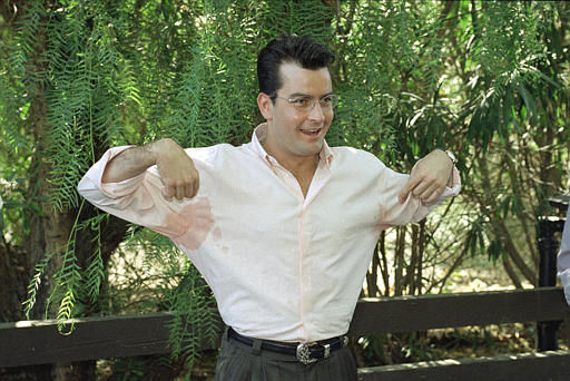 Actor Charlie Sheen displays sweaty armpits to reporters who wanted to know if he had any pre-nuptial jitters, Sept. 3, 1995.  Sheen, who turns 30 today, is set to marry model Donna Peele, 25, later Sunday at his Malibu ranch in Santa Monica, Calif.  &#40;AP Photo&#47;Reed Saxon&#41; <span class=meta>(AP Photo&#47; REED SAXON)</span>