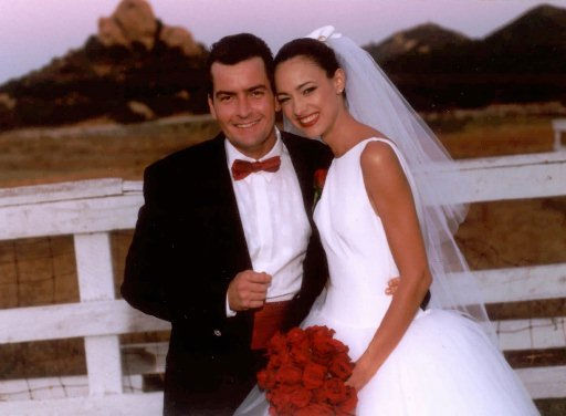 FILE -- Actor Charlie Sheen and his bride Donna Peele pose for a photo after they were married Sept. 4, 1995, in Malibu, Calif. In an interview scheduled to air Monday and Tuesday, Feb. 20 and 21, 1996, the actor told ``Entertainment Tonight&#39;&#39; he is divorcing Peele because he was suffocating and ``had to come up for air.&#39;&#39; &#40;AP Photo&#47;Bob Marshak&#47;JBPR&#41; <span class=meta>(AP Photo&#47; BOB MARSHAK)</span>