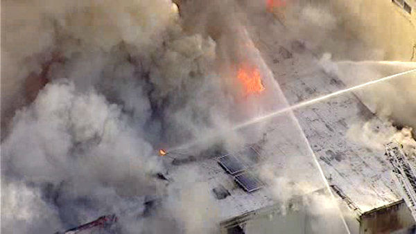 "<div class=""meta ""><span class=""caption-text "">A five-alarm fire burned throughout the day Wednesday inside a warehouse on Ewing Avenue in North Arlington, NJ. (WABC Photo)</span></div>"