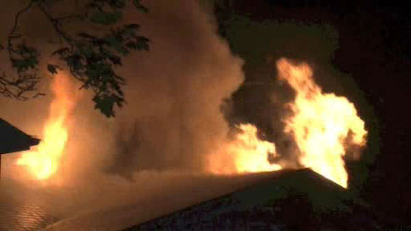A three-alarm tore through the roof of a home in Greenburgh, Westchester County early Sunday morning.