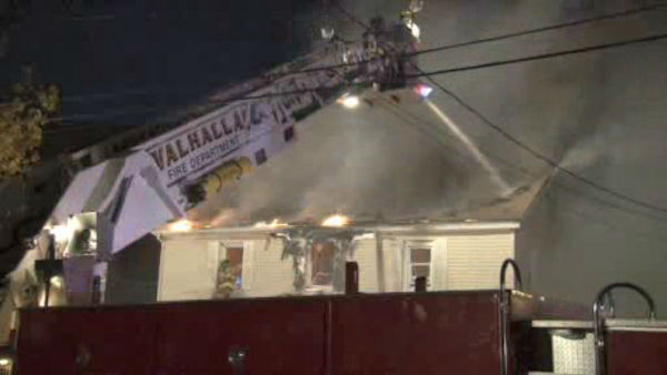 "<div class=""meta image-caption""><div class=""origin-logo origin-image ""><span></span></div><span class=""caption-text"">A three-alarm tore through the roof of a home in Greenburgh, Westchester County early Sunday morning.</span></div>"