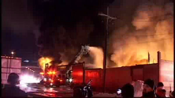 "<div class=""meta ""><span class=""caption-text "">Firefighters battled a large fire early Saturday morning at a building supply company in Greenpoint.</span></div>"
