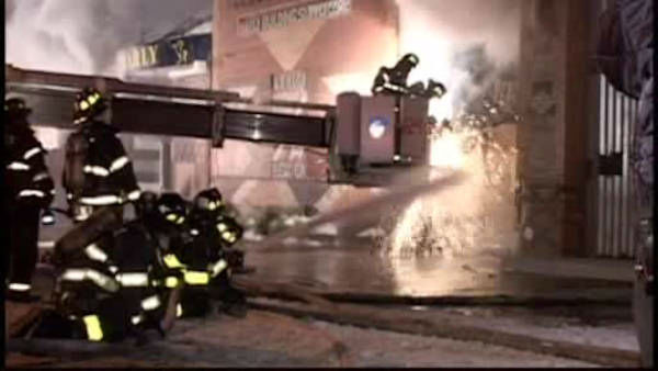 Firefighters battled a large fire early Saturday morning at a building supply company in Greenpoint.