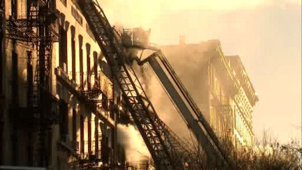 "<div class=""meta ""><span class=""caption-text "">Firefighters battled a three-alarm fire Sunday morning at a five-story apartment building on West 138th Street in Harlem.</span></div>"