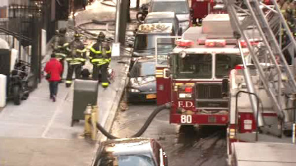 Firefighters battled a three-alarm fire Sunday morning at a five-story apartment building on West 138th Street in Harlem.