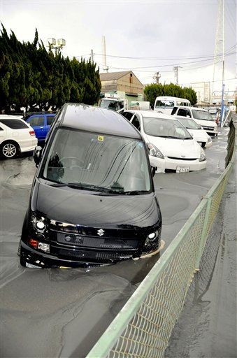 In this photo taken Friday, March 11, 2011, cars are swallowed in mud at Keiyo industrial zone on the liquefaction of the ground caused by a powerful earthquake in Ichikawa city, Chiba prefecture, Japan. One of Japan&#39;s strongest earthquakes ever recorded hit the country&#39;s east coast Friday. &#40;AP Photo&#47;The Yomiuri Shimbun, Masahiro Washisu&#41; JAPAN OUT, CREDIT MANDATORY <span class=meta>(AP Photo&#47; Masahiro Washisu)</span>