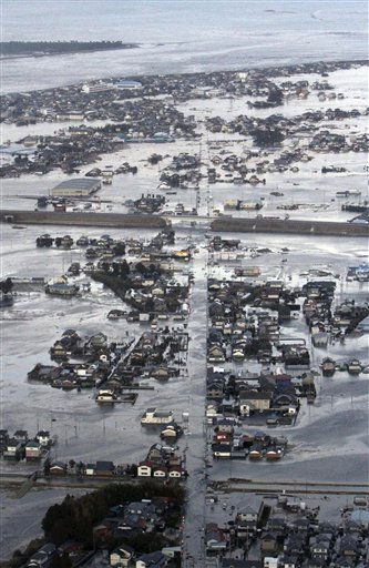 RETRANSMISSION WITH BETTER QUALITY - Buildings are submerged after an earthquake-triggered tsunami hit Yamamoto town in Miyagi prefecture &#40;state&#41;, Japan,  Friday March 11, 2011. The ferocious tsunami spawned by one of the largest earthquakes ever recorded slammed Japan&#39;s eastern coasts. &#40;AP Photo&#47;The Yomiuri Shimbun&#41; JAPAN OUT, CREDIT MANDATORY <span class=meta>(AP Photo&#47; Anonymous)</span>