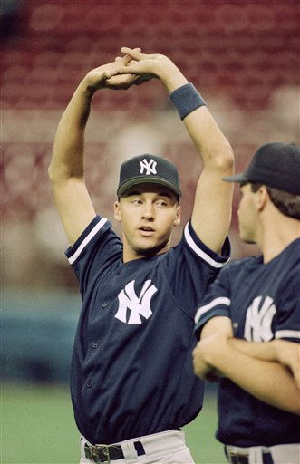 Rookie Derek Jeter of the New York Yankees warms up  Monday, May 29, 1995 in Seattle prior to a game against the Mariners. Jeter joined the Yankees in the day after being promoted from their Class AAA team in Columbus. Jeter was the Yankees? first pick in the June 1992 free-agent draft. &#40;AP Photo&#47;Gary Stewart&#41; <span class=meta>(AP Photo&#47; Gary Stewart)</span>