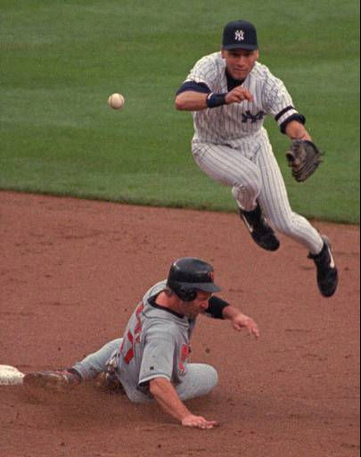 Baltimore Orioles runner B.J. Surhoff is forced out at second as New York Yankees shortstop Derek Jeter throws to first in the second inning Sunday June 30, 1996 at Yankee Stadium in New York. &#40;AP Photo&#47;Ron Frehm&#41; <span class=meta>(AP Photo&#47; RON FREHM)</span>