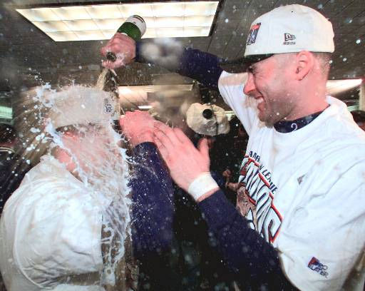 New York Yankees Derek Jeter, right, sprays teammate Chuck Knoblauch with champagne after clinching the American League Championship by beating the Cleveland Indians 9-5 in Game 6 Tuesday, Oct. 13, 1998 at Yankee Stadium in New York. &#40;AP Photo&#47;Mark Lennihan&#41; <span class=meta>(AP Photo&#47; MARK LENNIHAN)</span>