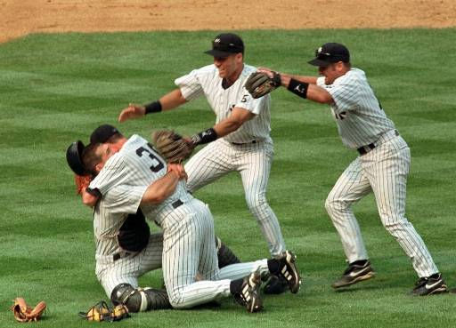 New York Yankees pitcher David Cone falls into the arms of  catcher Joe Girardi, left, as teammates Derek Jeter, center, and Chuck Knoblauch, right, join in the celebration after Cone threw a perfect game against the Montreal Expos during &#34;Yogi Berra Day&#34; at New York&#39;s Yankee Stadium Sunday, July 18, 1999.&#40;AP Photo&#47;Louis Requena&#41; <span class=meta>(AP Photo&#47; LOUIS REQUENA)</span>