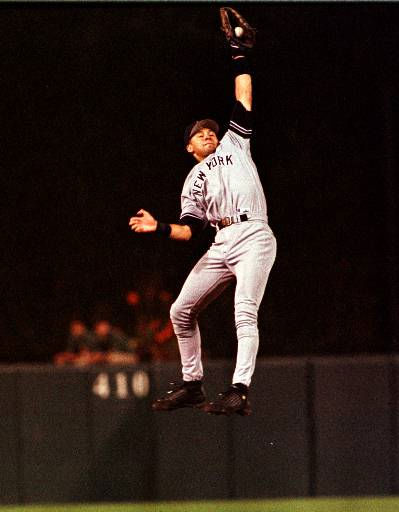 New York Yankees shortstop Derek Jeter leaps high to successfully catch a line drive hit by Baltimore Orioles Charles Johnson in the third inning of a game at Camden Yards in Baltimore Tuesday, Sept. 28, 1999.  &#40;AP Photo&#47;Nick Wass&#41; <span class=meta>(AP Photo&#47; NICK WASS)</span>