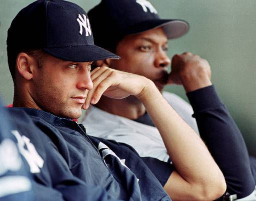 New York Yankees Derek Jeter and Dwight Gooden look on as the Yankees lose to the Baltimore Orioles for the third straight time in as many days, Sunday, Oct.1, 2000, at Camden Yards in Baltimore. The Orioles beat the Yankees 7-3.&#40;AP Photo&#47;Ricky Carioti&#41; <span class=meta>(AP Photo&#47; RICKY CARIOTI)</span>