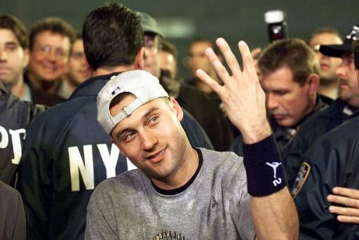New York Yankees Derek Jeter holds up four fingers to signify his four World Series Championships after beating the New York Mets 4-2  in Game 5 to clinch the series Friday, Oct. 26, 2000, at Shea Stadium in New York. &#40;AP Photo&#47;Amy Sancetta &#41; <span class=meta>(AP Photo&#47; AMY SANCETTA)</span>