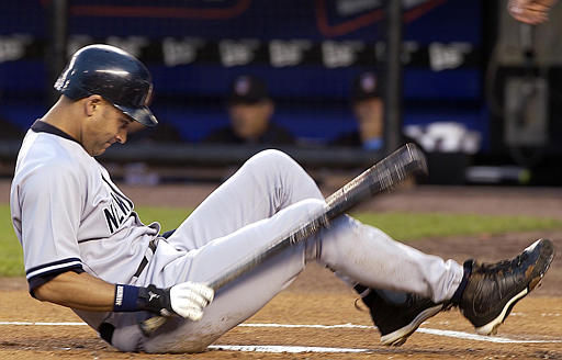 New York Yankees&#39; Derek Jeter lands on the ground after a a foul tip struck his knee during the first inning against the New York Mets at Shea Stadium in New York, Sunday, June 16, 2002. Jeter left the game with a bruised knee. &#40;AP Photo&#47;Ed Betz&#41; <span class=meta>(AP Photo&#47; ED BETZ)</span>
