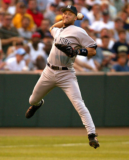 New York Yankees shortstop Derek Jeter leaps and throws to first base in a vain effort to throw out Baltimore Orioles Geronimo Gil on an infield single in the second inning of a game at Camden Yards in Baltimore Tuesday, June 25, 2002.&#40;AP Photo&#47;Roberto Borea&#41; <span class=meta>(AP Photo&#47; ROBERTO BOREA)</span>
