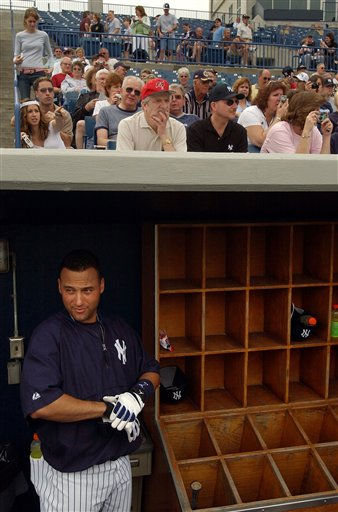 New York Yankees&#39; Derek Jeter, bottom, puts on his batting gloves as he gets ready to take batting practice as fans, above, look on at the team workout on the field during spring training, Friday, Feb. 25, 2005, in Tampa, Fla. &#40;AP Photo&#47;Tony Gutierrez&#41; <span class=meta>(AP Photo&#47; TONY GUTIERREZ)</span>