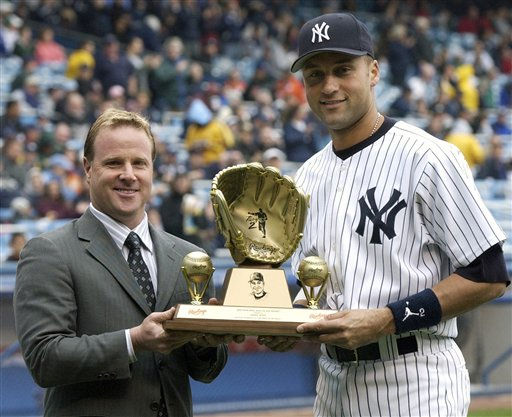 New York Yankees shortstop Derek Jeter, right, receives a gold glove award from Rawlings representative Steve Cohen before the game Saturday, April 23, 2005 at Yankee Stadium in New York. &#40;AP Photo&#47;Bill Kostroun&#41; <span class=meta>(AP Photo&#47; BILL KOSTROUN)</span>