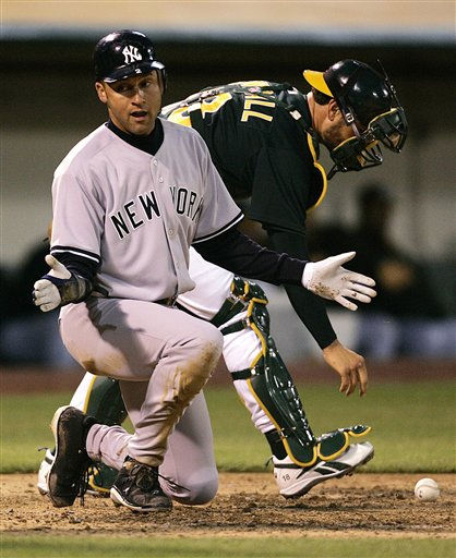 New York Yankees&#39; Derek Jeter, left, scores past Oakland Athletics catcher Jason Kendall in the third inning of a baseball game Tuesday, April 4, 2006, in Oakland, Calif. Jeter scored on a double by Gary Sheffield. &#40;AP Photo&#47;Ben Margot&#41; <span class=meta>(AP Photo&#47; BEN MARGOT)</span>