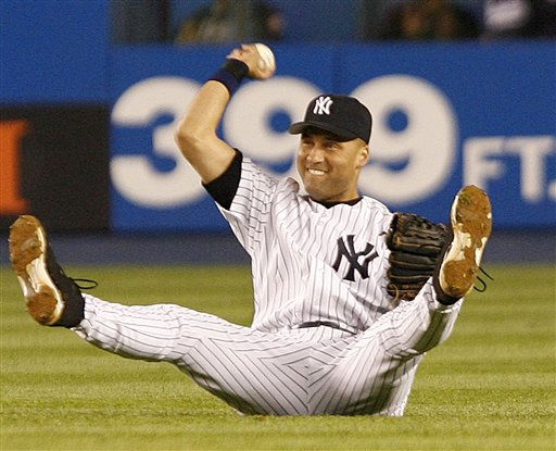 New York Yankees&#39; Derek Jeter throws the ball after making the catch on a fly out by Boston Red Sox&#39;s Kevin Youkilis in the third inning Wednesday, May 10, 2006, at Yankee Stadium in New York. &#40;AP Photo&#47;Kathy Willens&#41; <span class=meta>(AP Photo&#47; KATHY WILLENS)</span>
