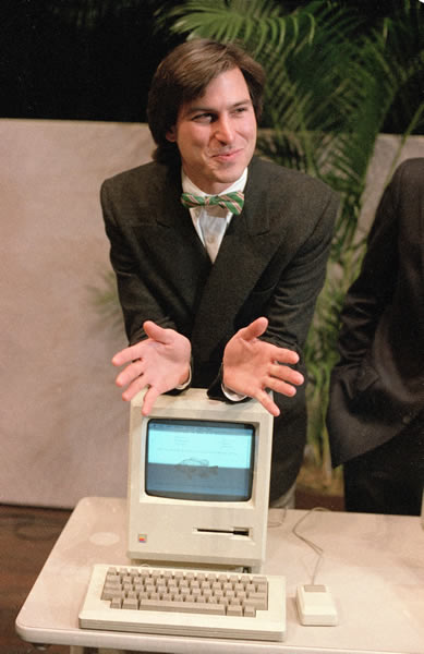 In this Jan. 24, 1984 file photo, Steve Jobs, chairman of the board of Apple Computer, leans on the new Macintosh personal computer following a shareholder&#39;s meeting in Cupertino, Ca. Apple Inc. on Wednesday, Aug. 24, 2011 said Jobs is resigning as CEO, effective immediately. He will be replaced by Tim Cook, who was the company&#39;s chief operating officer. It said Jobs has been elected as Apple&#39;s chairman. <span class=meta>(AP Photo&#47;Paul Sakuma)</span>