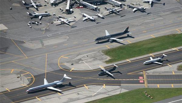 Planes taxi on runways at LaGuardia Airport, Monday, Sept. 8, 2008 in New York. (AP Photo/Mark Lennihan)
