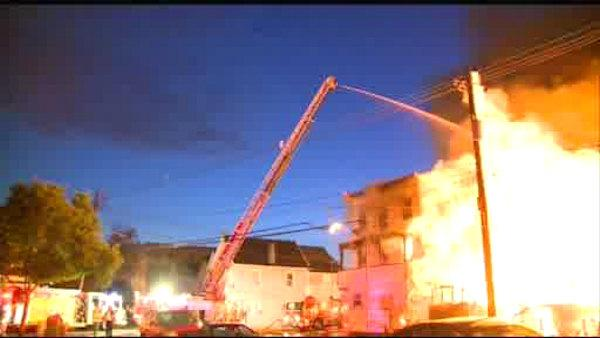 A huge fire burns through a row of houses in Perth Amboy, New Jersey