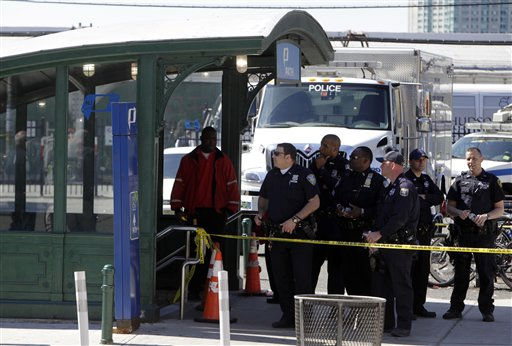 "<div class=""meta ""><span class=""caption-text "">Emergency personnel gather near the entrance to the PATH station in Hoboken, Sunday, May 8, 2011. A spokesman says a train pulling into the station struck an abutment, causing minor injuries. (AP Photo/Seth Wenig) (AP Photo/ Seth Wenig)</span></div>"