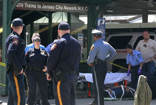 An unidentified man, who was injured during a PATH train crash at the Hoboken Terminal, is seen on a stretcher as medical officials prepare to take him to the hospital, Sunday, May 8, 2011, in Hoboken, N.J. A spokesman says a train pulling into the station struck an abutment, causing minor injuries. &#40;AP Photo&#47;Julio Cortez&#41; <span class=meta>(AP Photo&#47; Julio Cortez)</span>