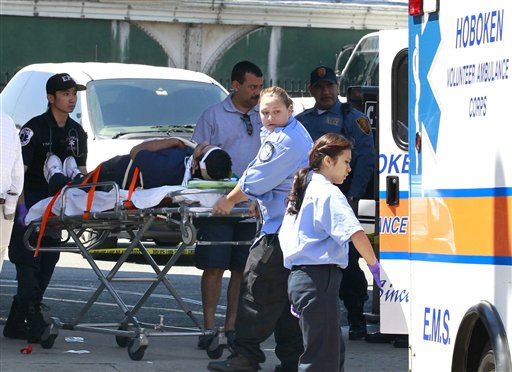 An unidentified man, who was injured during a PATH train crash at the Hoboken Terminal, is seen on a stretcher as medical officials prepared to take him to the hospital, Sunday, May 8, 2011, in Hoboken, N.J. A spokesman says a train pulling into the station struck an abutment, causing minor injuries. &#40;AP Photo&#47;Julio Cortez&#41; <span class=meta>(AP Photo&#47; Julio Cortez)</span>