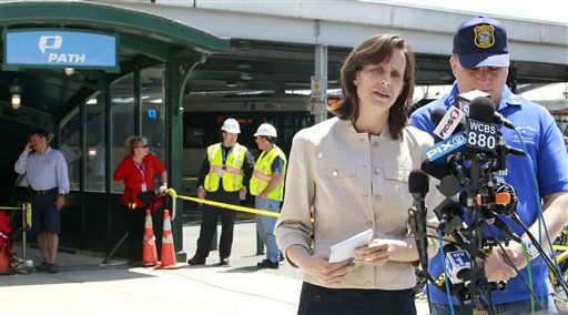 Hoboken Mayor Dawn Zimmer, left, and Hoboken Police Capt. James Fitzsimmons give details of the PATH train crash outside of the Hoboken Terminal, Sunday, May 8, 2011 in Hoboken, N.J. Zimmer said there were 34 injured people. &#40;AP Photo&#47;Julio Cortez&#41; <span class=meta>(AP Photo&#47; Julio Cortez)</span>