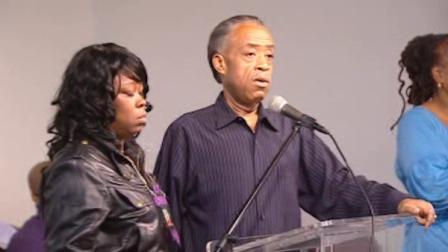 The Rev. Al Sharpton at a rally in Harlem with the mother of Tamon Robinson