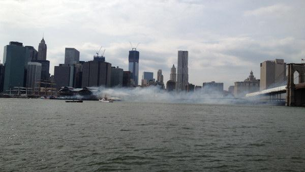 Firefighters battled a fire beneath a pier at the South Street Seaport
