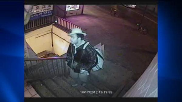 Police arrest a suspect in a rape at a Queens massage parlor