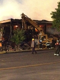 "<div class=""meta ""><span class=""caption-text "">At around 8:45 p.m., bulldozers began tearing down parts of the building to find hidden flames.  (Lucy Yang, Eyewitness News)</span></div>"