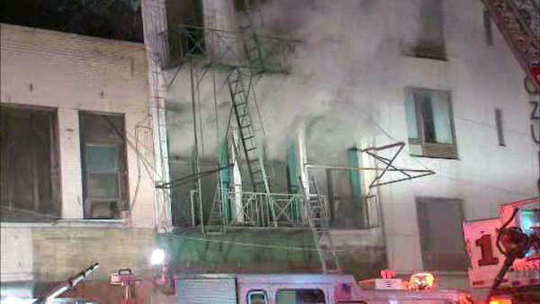 Firefighters battled a three-alarm fire early Saturday morning at an apartment building on Canal Street. ( P