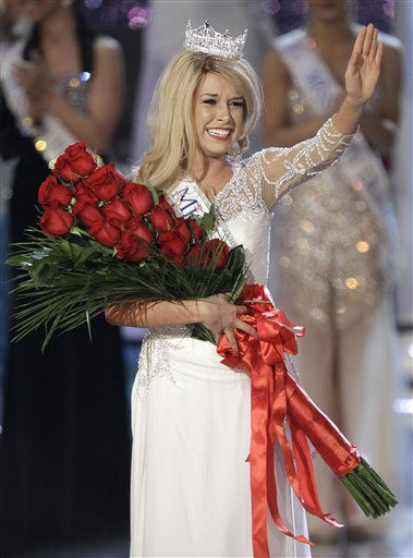 "<div class=""meta ""><span class=""caption-text "">Teresa Scanlan, Miss Nebraska waves to the audience after being crowned Miss America 2011 during the Miss America pageant, Saturday, Jan. 15, 2011 in Las Vegas. (AP Photo/Julie Jacobson) (AP Photo/ Julie Jacobson)</span></div>"