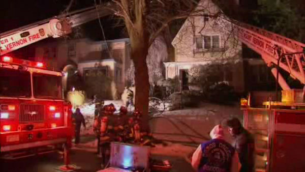 "<div class=""meta image-caption""><div class=""origin-logo origin-image ""><span></span></div><span class=""caption-text"">Firefighters battled a two-alarm fire Monday night at a home on Magnolia Avenue in Mount Vernon.</span></div>"