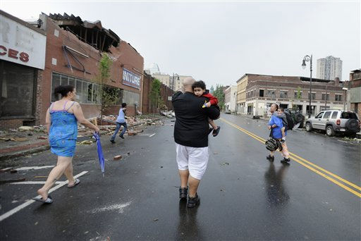 People seek cover after an announcement of another possible tornado in Springfield, Mass., Wednesday, June 1, 2011.  An apparent tornado struck downtown Springfield, one of Massachusetts&#39; largest cities, scattering debris, toppling trees, and frightening workers and residents. &#40;AP Photo&#47;Jessica Hill&#41; <span class=meta>(AP Photo&#47; Jessica Hill)</span>