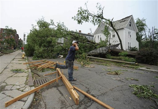 A man talks on his phone near storm damage after a reported tornado struck downtown Springfield, Mass., Wednesday, June 1, 2011.  An apparent tornado struck downtown Springfield, one of Massachusetts&#39; largest cities, scattering debris, toppling trees, and frightening workers and residents. &#40;AP Photo&#47;Jessica Hill&#41; <span class=meta>(AP Photo&#47; Jessica Hill)</span>