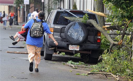 A woman runs with her child to safety after another report of a possible tornado in Springfield, Mass., Wednesday, June 1, 2011. An apparent tornado struck downtown Springfield, one of Massachusetts&#39; largest cities, scattering debris, toppling trees, and frightening workers and residents. &#40;AP Photo&#47;Jessica Hill&#41; <span class=meta>(AP Photo&#47; Jessica Hill)</span>