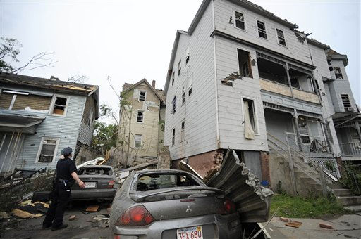 A police officer checks on people in a house after a reported tornado struck Springfield, Mass., Wednesday, June 1, 2011. An apparent tornado struck downtown Springfield, one of Massachusetts&#39; largest cities, scattering debris, toppling trees, and frightening workers and residents. &#40;AP Photo&#47;Jessica Hill&#41; <span class=meta>(AP Photo&#47; Jessica Hill)</span>
