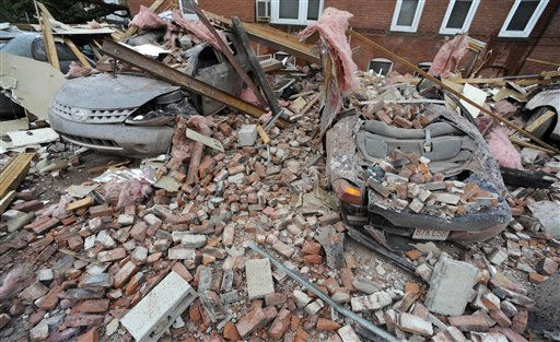 Bricks and debris that fell from a building lay on top of cars after a report of a tornado in Springfield, Mass., Wednesday, June 1, 2011. An apparent tornado struck downtown Springfield, one of Massachusetts&#39; largest cities, scattering debris, toppling trees, and frightening workers and residents. &#40;AP Photo&#47;Jessica Hill&#41; <span class=meta>(AP Photo&#47; Jessica Hill)</span>