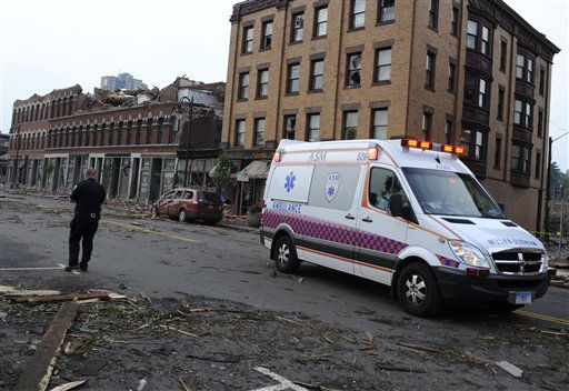 An ambulance drives past damaged buildings after a reported tornado in downtown Springfield, Mass., Wednesday, June 1, 2011. An apparent tornado struck the downtown of one of the state&#39;s largest cities on Wednesday afternoon, scattering debris, toppling trees and frightening workers and residents. Several injuries were reported. &#40;AP Photo&#47;Jessica Hill&#41; <span class=meta>(AP Photo&#47; Jessica Hill)</span>